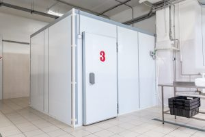 industrial cooling chamber from the outside. White doors in the room