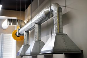 An example of installing exhaust ventilation over a workplace in an industrial area. Industrial Design.