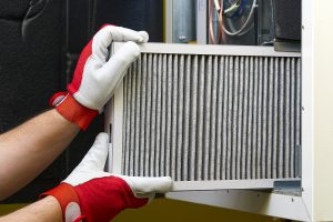 Replacing the filter in the central ventilation system. Replacing Dirty Air filter for home central air conditioning system. Change filter in rotary heat exchanger recuperator